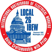 Badge of the Local 26 International Brotherhood of Electrical Workers. A red ring around  ablue building.