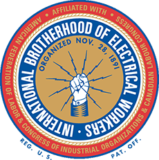 Badge of the International Brotherhood of Electrical Workers. A blue ring around a gold field showing light coming out of a raised fist.